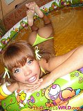Petite Thai cutie takes pictures of herself posing in a blowup pool