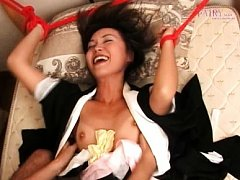 Maria Ibuki Asian is tied with ropes of bed and fi...